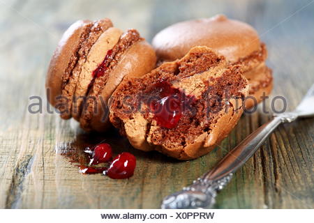Macaroons with chocolate-berry filling. - Stock Photo
