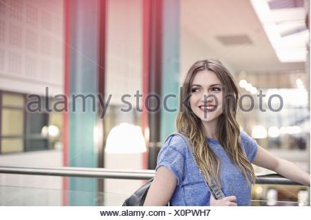 Young woman wearing blue t shirt looking away - Stock Photo