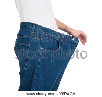 Woman Showing Her Old Jeans After Successful Diet - Stock Photo