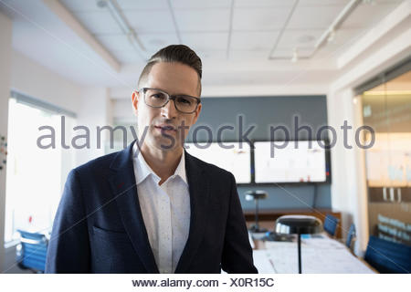 Portrait confident businessman in conference room - Stock Photo