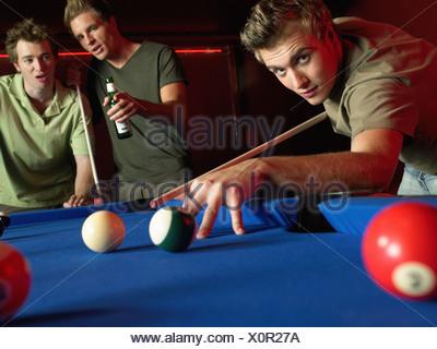 Men playing pool - Stock Photo