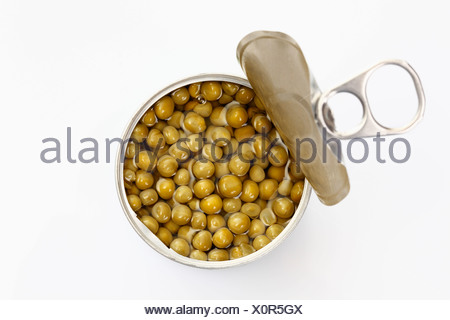 Opened tin of peas, from above - Stock Photo