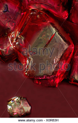 Sugar crystal, ordinary table sugar dissolves in cherry juice, photomicrography - Stock Photo