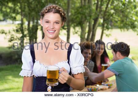 Pretty oktoberfest girl smiling at camera - Stock Photo
