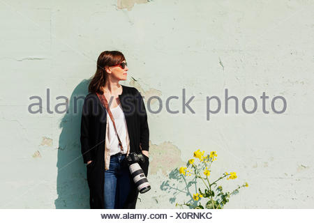 Young woman with SLR camera - Stock Photo