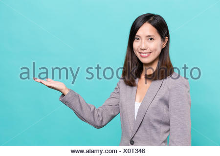 Business woman showing hand - Stock Photo