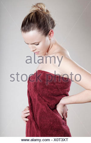 Young woman wrapped in towel - Stock Photo