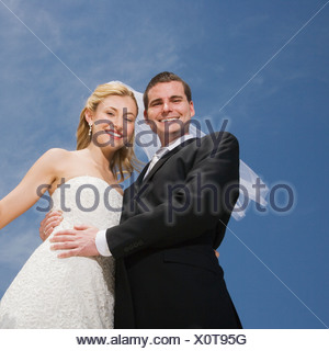 Low angle view of bride and groom - Stock Photo