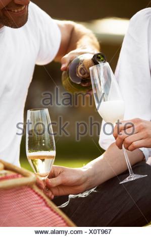 Couple having champagne Copenhagen Denmark. - Stock Photo