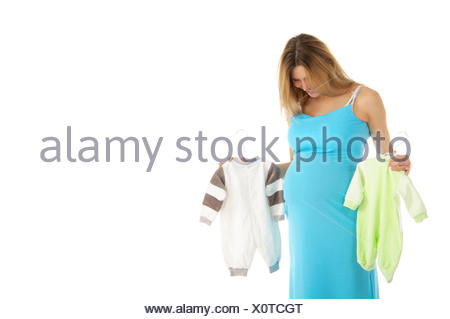 pregnant woman buying baby clothes - Stock Photo