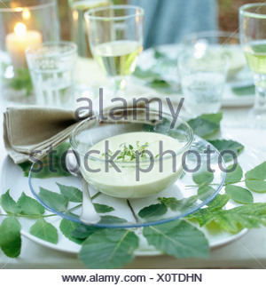 A laid table, Velamsund, Sweden. - Stock Photo