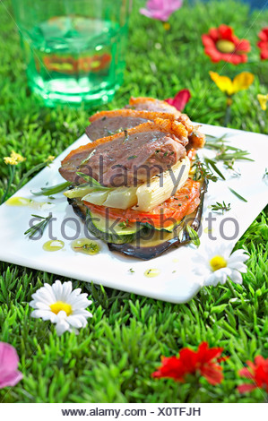 Duck magret and summer vegetable mille-feuille - Stock Photo