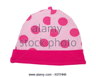 Pink baby hat with polka dots - Stock Photo