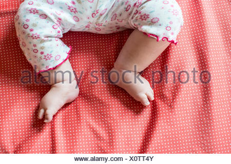 Close-up of a baby girl's feet - Stock Photo