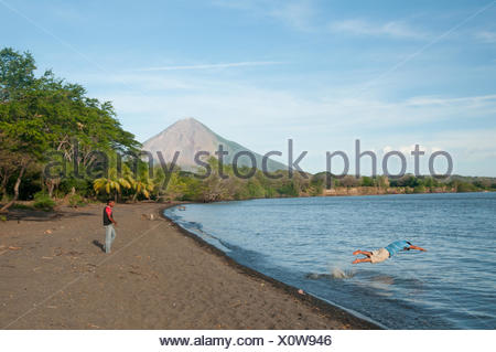 Locals from the Ometepe Island swimming in Lake Cocibolca, or Lake Nicaragua. - Stock Photo