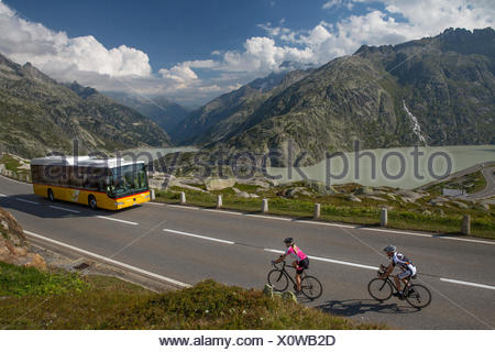 Postbus, riding a bicycle, Grimsel Pass, glacier, ice, moraine, bicycle, bicycles, bike, riding a bicycle, racing bicycle, canto - Stock Photo