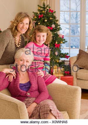 Multi-generation family near Christmas tree - Stock Photo