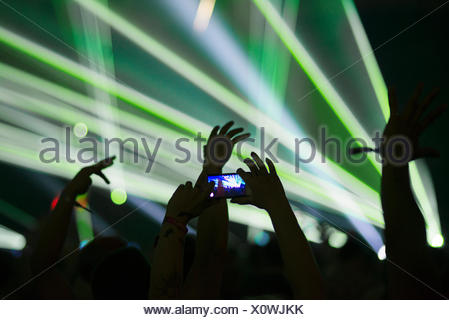 Finland, Uusimaa, Helsinki, Man taking photos with smartphone at Summer Sound Festival - Stock Photo