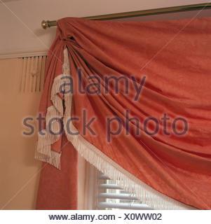 Close-up of a draped peach curtain - Stock Photo