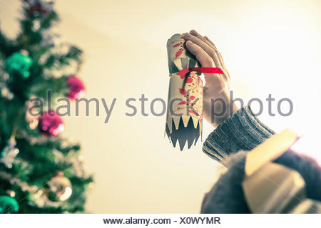 Person holding used christmas cracker - Stock Photo