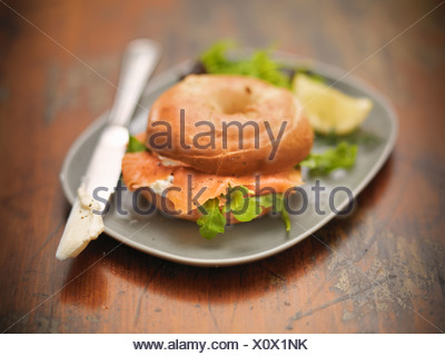 Roll with cream cheese and salmon - Stock Photo