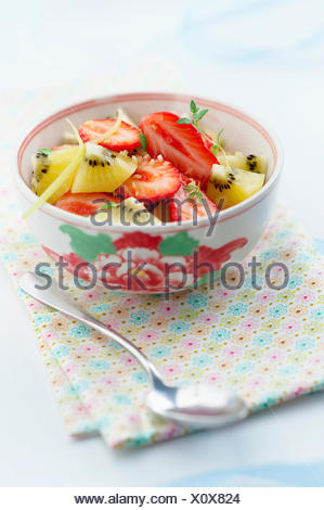 Strawberry and yellow kiwi fruit salad - Stock Photo