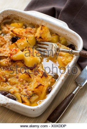 Fish with potatoes cooked in oven - Stock Photo