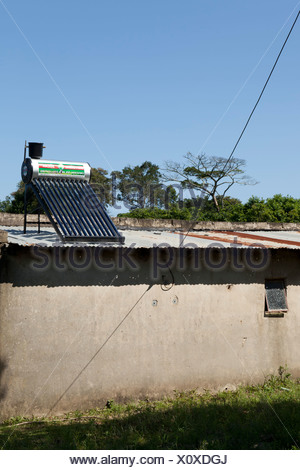 Residential home with solar power panels on the roof - Stock Photo