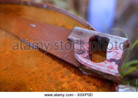 tool isolated antique teeth steel rusty rust rusted handle saw farm cut mill blade dark apart circular slice old do obsolete - Stock Photo