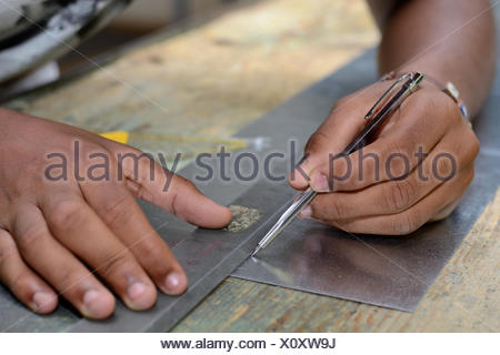 Skilled workers working with scriber - Stock Photo