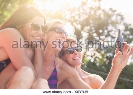 Three mature women in swimwear, taking self portrait - Stock Photo
