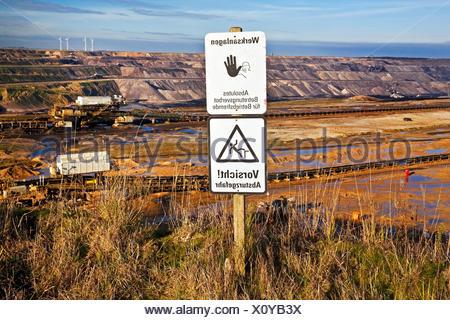 warning sign in front of Garzweiler II brown coal surface mining, Germany, North Rhine-Westphalia, Garzweiler - Stock Photo