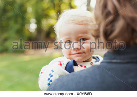 Portrait of cute baby girl with father at park - Stock Photo
