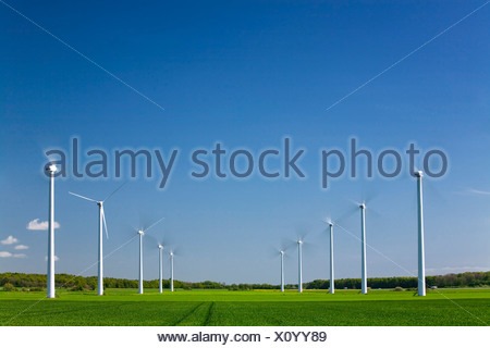 Wind turbines on the landscape against clear blue sky - Stock Photo