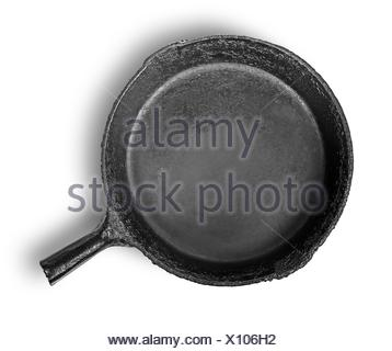 Empty old cast iron frying pan isolated on white background. - Stock Photo