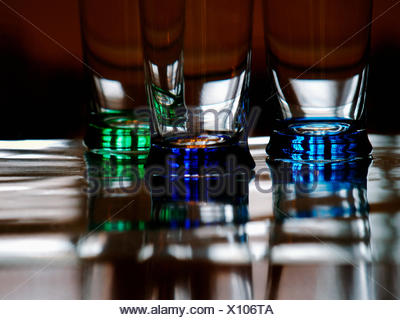 Three Coloured Glasses On A Table In A Bar - Stock Photo