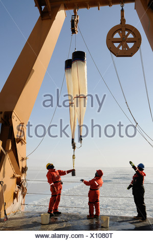 Alaska, Bering Sea. Lowering net 'bongos' over the stern of ship to capture marine life. Studying Ice Condiitons and Changing - Stock Photo