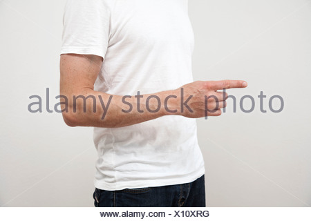 Close up of man's pointing finger - Stock Photo