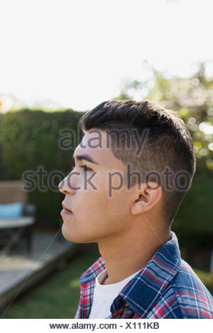 Close up profile serious pensive brunette young man - Stock Photo