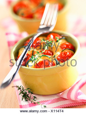 Tomato and courgettes in batter - Stock Photo