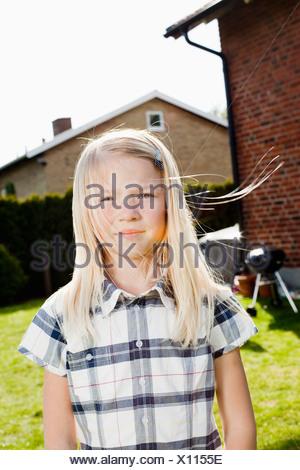 Wind in girls hair - Stock Photo