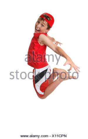 Happy boy mid jump - Stock Photo