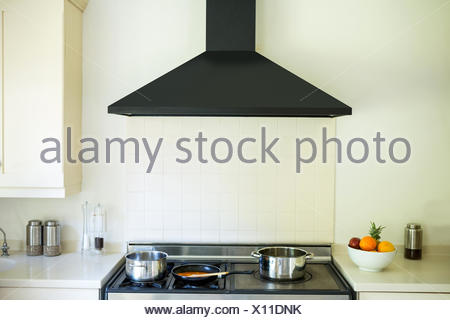 Modern Kitchen With An Induction Chimney And Cooker   Stock Photo