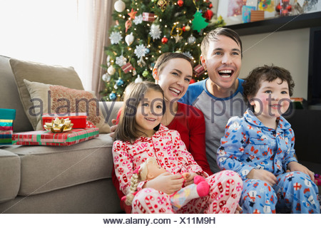 Cheerful family at home during Christmas - Stock Photo