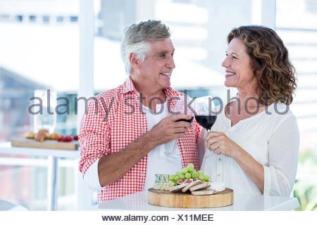 Happy couple toasting wineglasses at restaurant - Stock Photo
