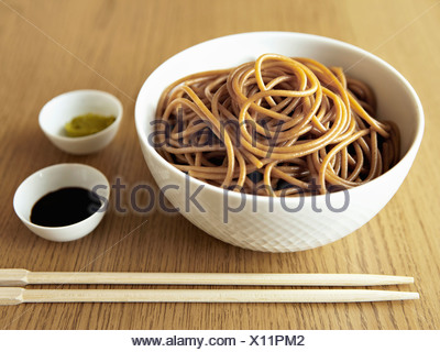 Bowl of noodles with chopsticks - Stock Photo