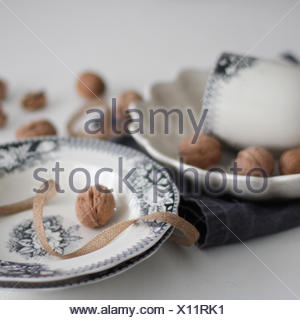Walnuts on china plates - Stock Photo