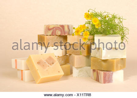 group of handmade soap with herbal material - Stock Photo