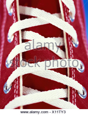 Sneakers red lacing close-up footwear shoes athletically sneakers gym shoes linen-shoes shoelaces shoelaces knows detail trendy - Stock Photo