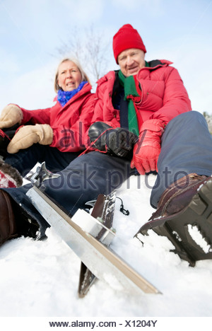 Closeup on Two people sitting outdoors - Stock Photo